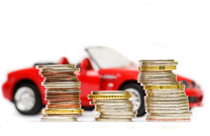 Stacked coins with red car