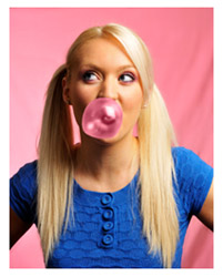 Blonde girl blowing a bubble