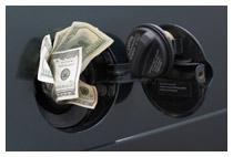 Hundred Dollar bills stuffed in a car's gas tank