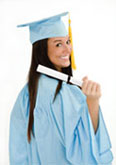 A cute female college student in graduation gown