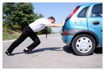 Man pushing his car