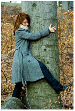 A woman hugging a tree