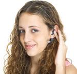 Woman using hands-free earpiece