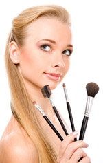 A woman holding makeup brushes