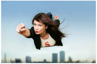 A woman flying over a city dressed as a superhero
