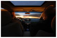 The interior of a car at night