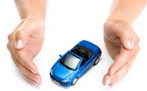 Hands enclosing a toy car