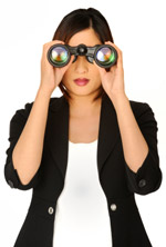 A woman with binoculars