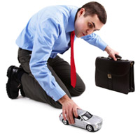 Man with toy car and briefcase