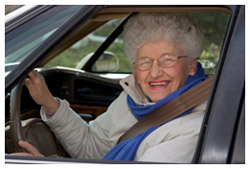 An old woman in a car